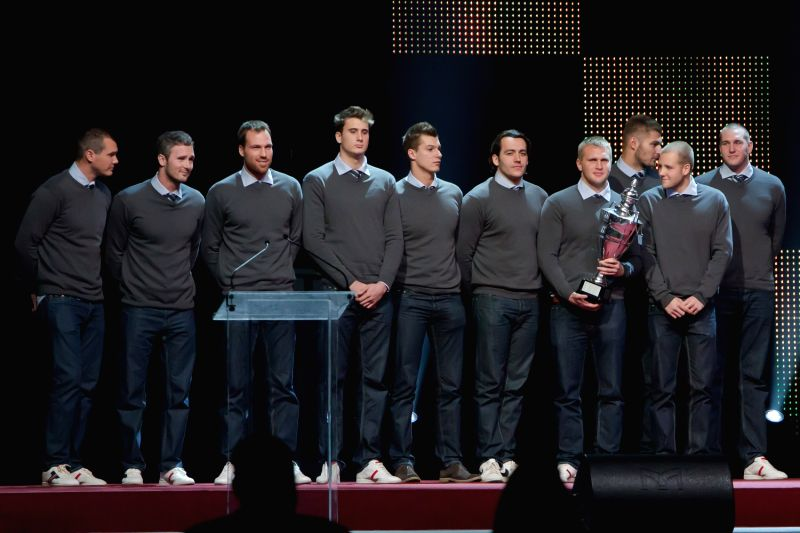 Members of the Hungarian men's water polo team pose with the trophy for the Hungarian team of the year 2013 in Budapest Dec. 19, 2013. Hungarian sports ..