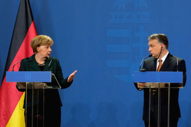 Hungarian Prime Minister Viktor Orban (R) and German Chancellor Angela Merkel hold a press conference after their meeting in Budapest Feb. 2, 2015. Angela Merkel ... - Viktor Orban