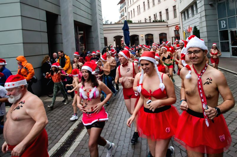 """Budapest (Hungary): Half naked runners attend the 11th """"Santa Speedo Run"""" for charity in Budapest, Hungary on Dec. 7, 2014. The event aims to raise money for Budapest's Burattino School ..."""