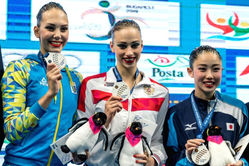 BUDAPEST, July 19, 2018 - Silver medalist Marta Fiedina(L) of Ukraine, gold medalist Varvara Subbotina(C) of Russia, bronze medalist Mana Fujiwara of Japan attend the awarding ceremony of solo free ...