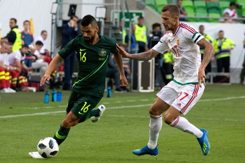 BUDAPEST, June 10, 2018 - Aziz Behich (L) of Australia vies with Roland Varga of Hungary during the friendly match at the Groupama Arena in Budapest, Hungary on June 9, 2018. Australia won 2-1.