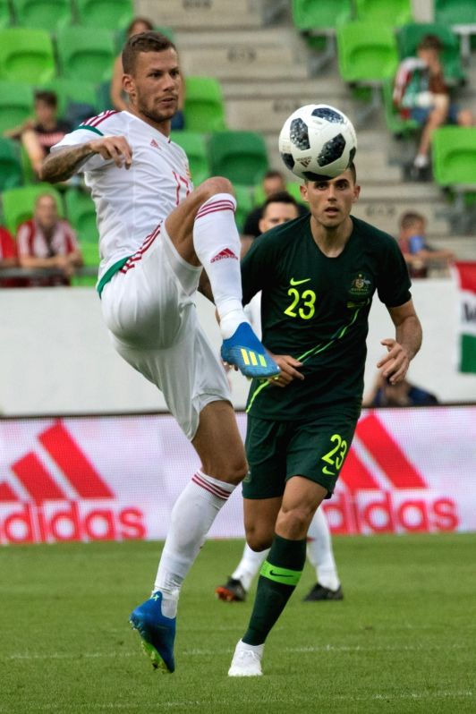 BUDAPEST, June 10, 2018 - Roland Varga (L) of Hungary vies with Tom Rogic of Australia during the friendly match at the Groupama Arena in Budapest, Hungary on June 9, 2018. Australia won 2-1.