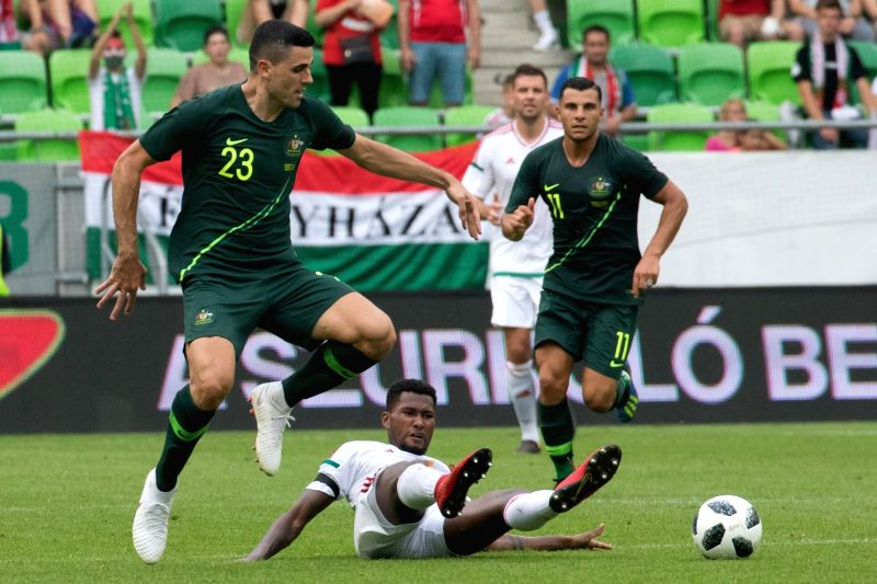 BUDAPEST, June 10, 2018 - Tom Rogic (L) of Australia vies with Paulo Vinicius (bottom) of Hungary  during the friendly match at the Groupama Arena in Budapest, Hungary on June 9, 2018. Australia won ...