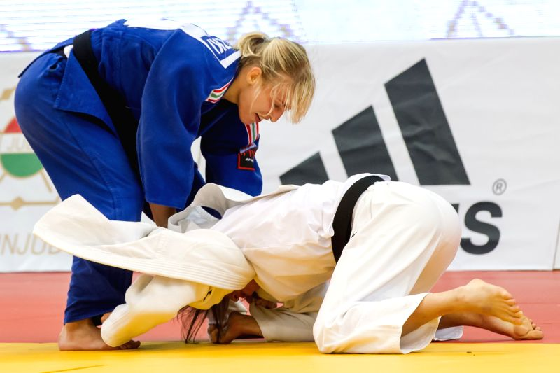 Hungary's Eva Csernoviczki (L) vies with Italy's Valentina Moscatt during women's -48 kg final of the IJF Budapest Judo Grand Prix in Budapest, Hungary on June 21,