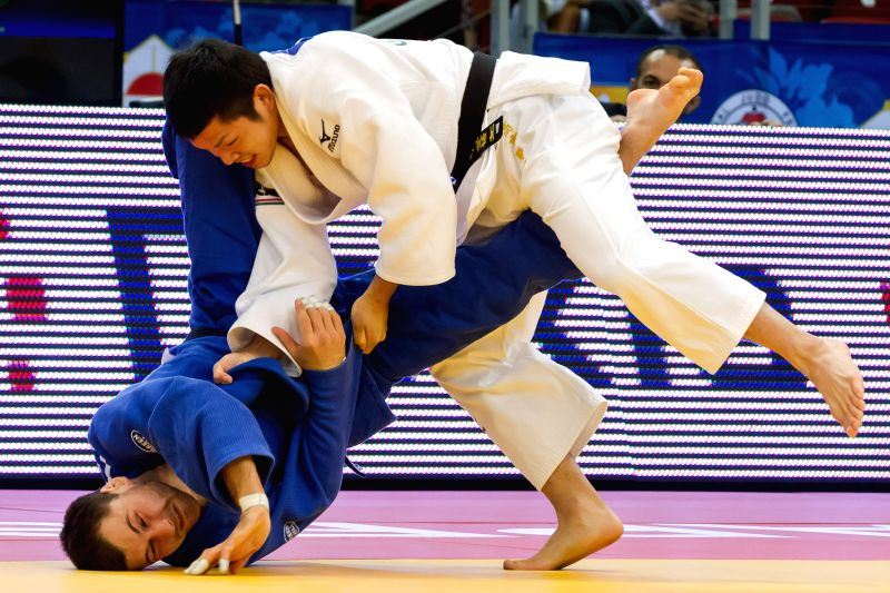 Takaichi Kengo (R) of Japan fights against  Dzmitry Shershan of Belarus during men's -66 kg final of the IJF Budapest Judo Grand Prix in Budapest, Hungary on June .