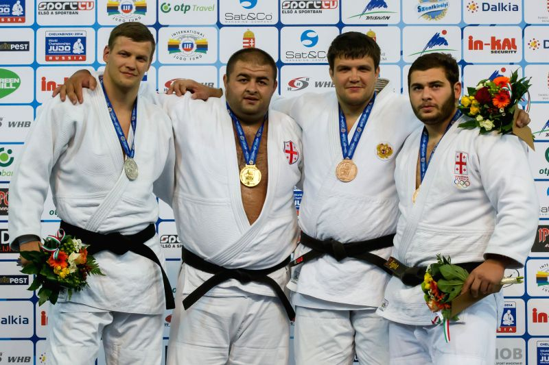 Gold medalist Adam Okruashvili (2nd L) of Georgia, silver medalist Marius Paskevicius (L) of Lithuania, bronze medalists Andrey Volkov (2nd R) of Russia and Levani