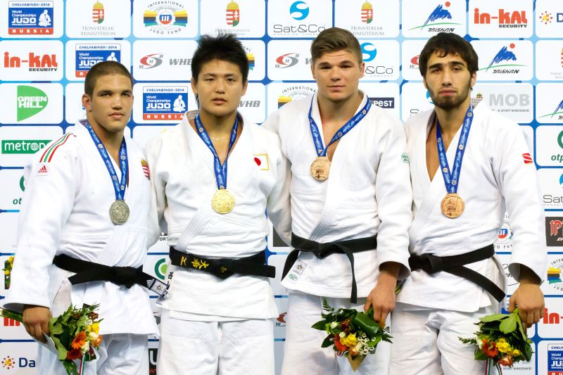 Gold medalist Daiki Nishiyama (2nd L) of Japan, silver medalist Krisztian Toth (L) of Hungary, bronze medalists Khusen Khalmurzaev(R) of Russia and Noel Van T End .