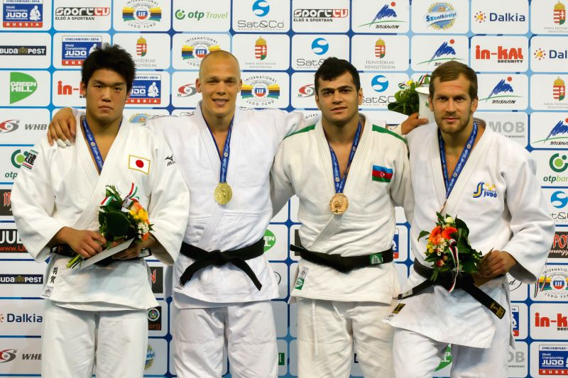 Gold medalist Henk Grol (2nd L) of Netherlands, silver medalist Ryunosuke Haga (L) of Japan, bronze medalists Elmar Gasimov (2nd R) of Azerbaijan and Martin Pacek .