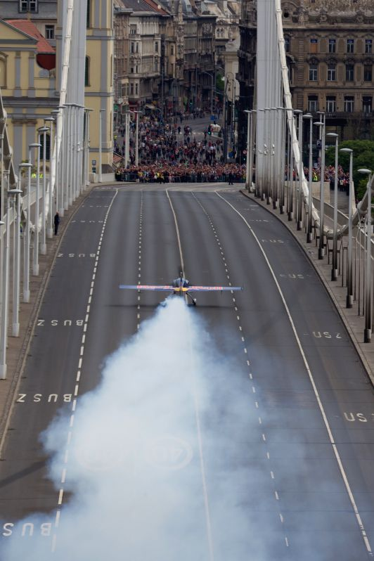 Hungary's Peter Besenyei takes off from Elisabeth Bridge with his airplane to fly his routine during an air show above river Danube in Budapest, Hungary, to mark the