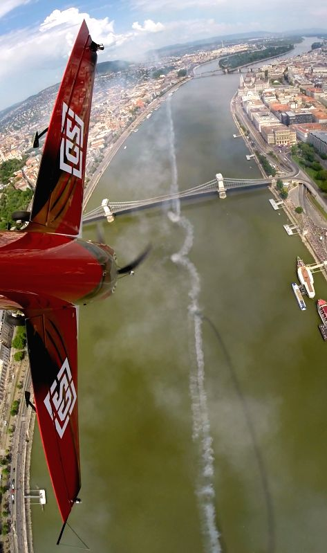 Hungary's Zoltan Veres flies with his airplane during an air show above river Danube in Budapest, Hungary, to mark the International Labor Day on May 1, 2014. Photo:
