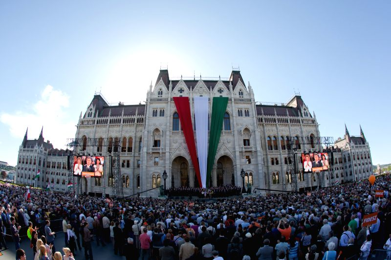 Hungarian new Prime Minister Viktor Orban addresses his party's rally in front of the Hungarian Parliament after being re-elected as prime minister in Budapest on ..