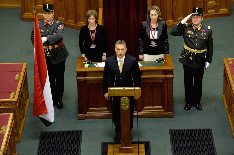 Hungarian new Prime Minister Viktor Orban takes the oath after being re-elected as prime minister in the Hungarian Parliament in Budapest on May 10, 2014. In a ...