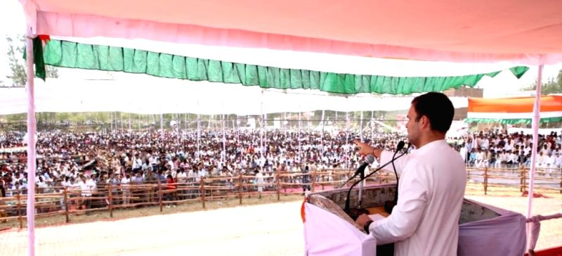 Budaun: Congress President Rahul Gandhi addresses a public rally, in Budaun, Uttar Pradesh, on April 18, 2019. (Photo: IANS)