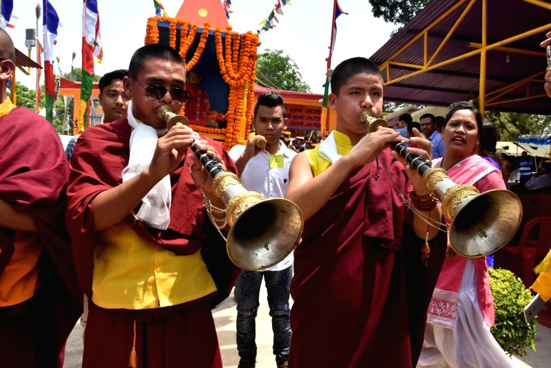 Buddhist devotees participate in a religious procession on Buddha Purnima at Jharkhand Armed Police (JAP-1) ground in Ranchi on May 10, 2017.