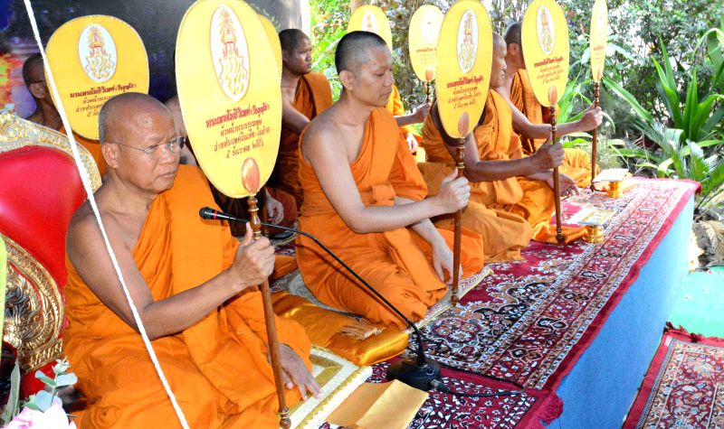 Buddhist monks from Thailand offer prayers during Songkran festival at Bodh Gaya's Thai Temple on April 13, 2015.