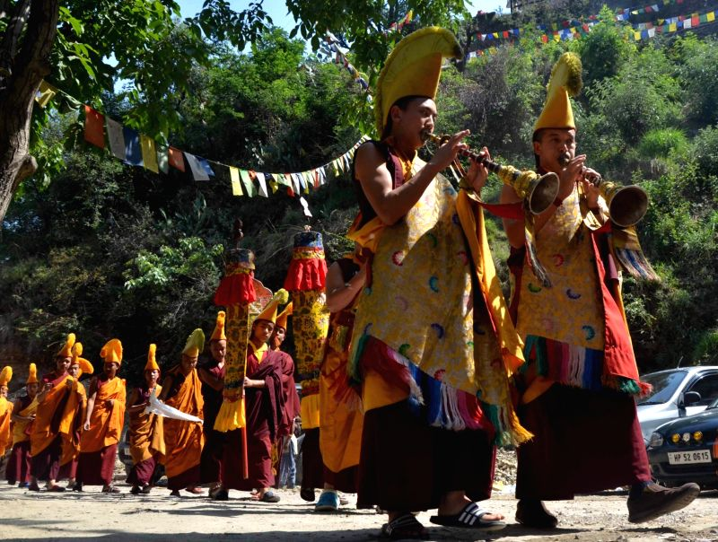 Buddhist monks offer prayers at the Tibetan monastery on the occasion of Buddha Jayanti celebration in Shimla on May 21, 2016.