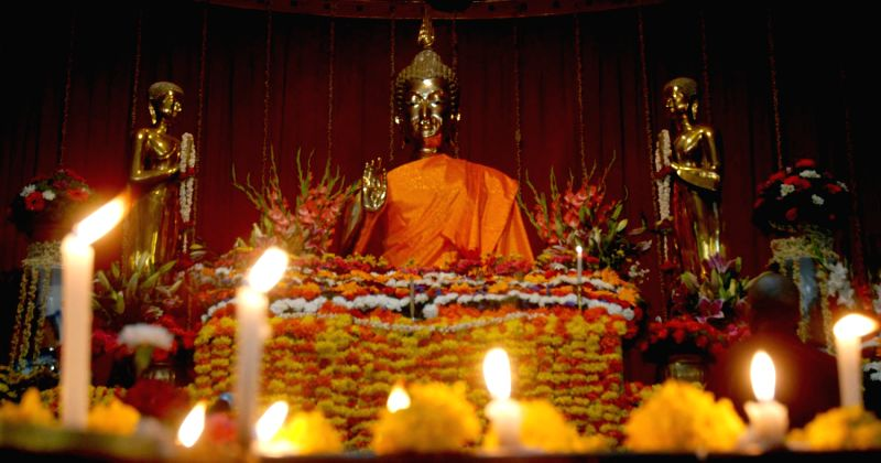 Buddhist Monks offering prayers on the Buddha's on the occasion of Guru Poornima at Maha Bodhi society in Bangalore