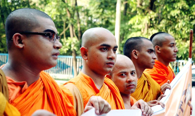 Buddhist monks participate in a rally organised on the eve of 2558th Buddha Jayanti in Kolkata on May 13, 2014.