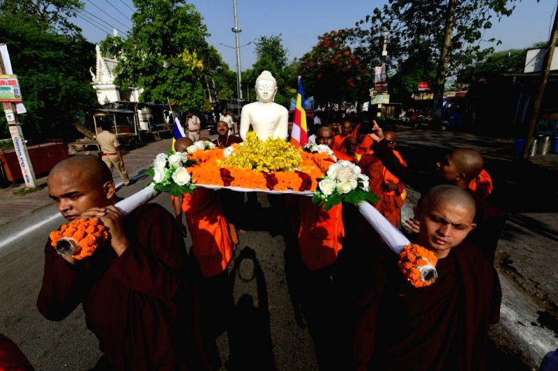 Gaya: Buddhist monks participate in a religious procession during Buddha Purnima celebrations in Bihar's Gaya district
