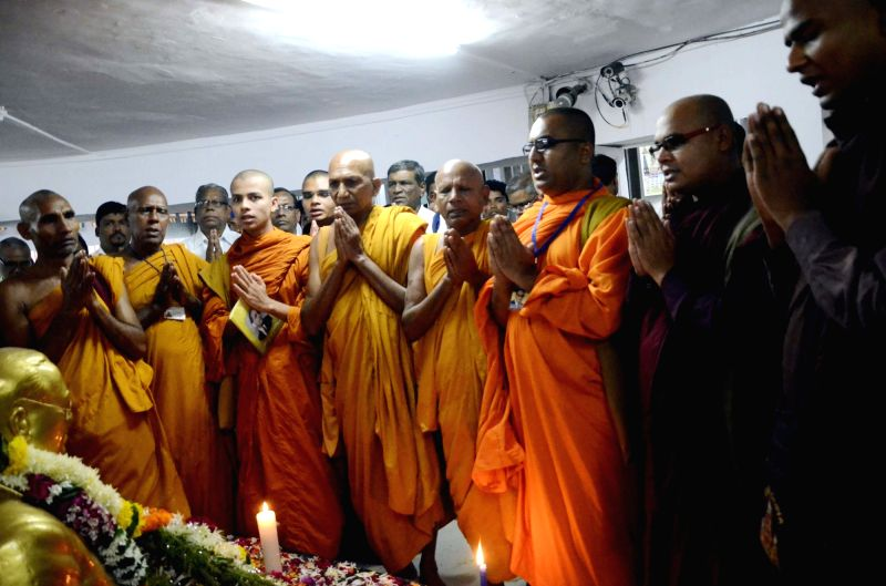 Buddhist monks pay homage to Babasaheb Dr. BR Ambedkar on 60th Mahaparinirvan Diwas in Mumbai on Dec 6, 2015.