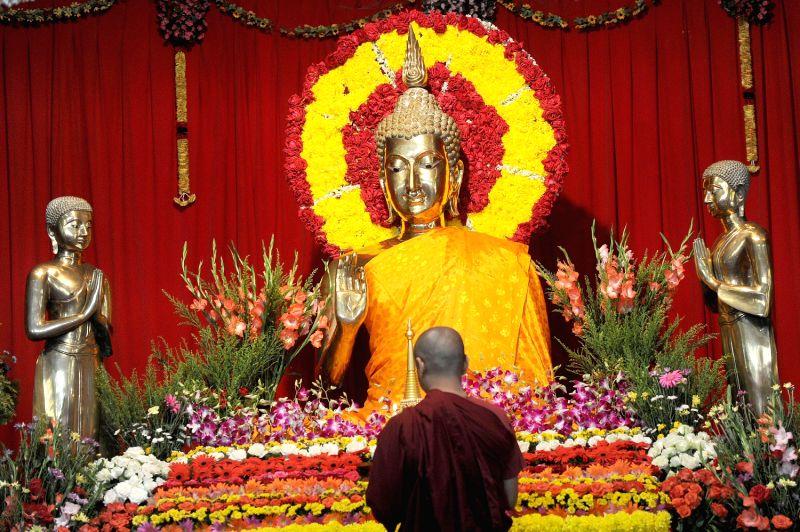 Buddhist Monks prayer on the Occasion of Budda Purnima at Mahabodhi Society in Bengaluru