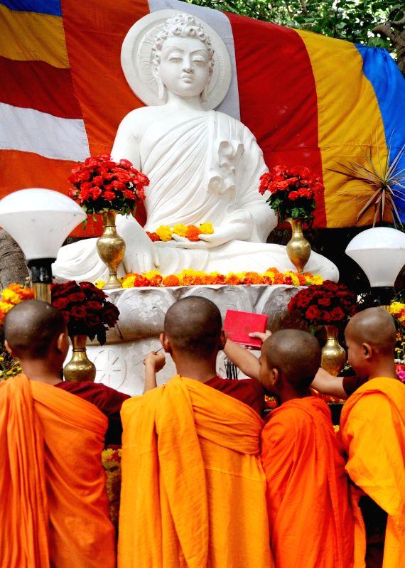 Buddhist Monks performing prayer on the Occasion of Budda Purnima