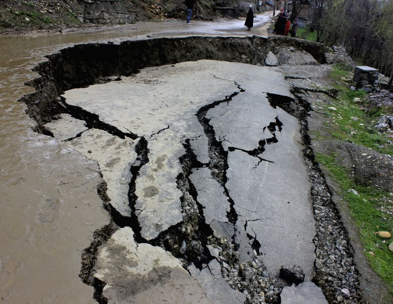A road caves-in at Surisyar village in Jammu and Kashmir's Budgam district on April 3, 2015.