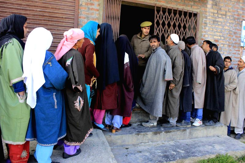 People queue-up to cast their votes during the third phase of Jammu and Kashmir assembly polls in Chrar-e-Sharif constituency Budgam district on Dec 9, 2014.