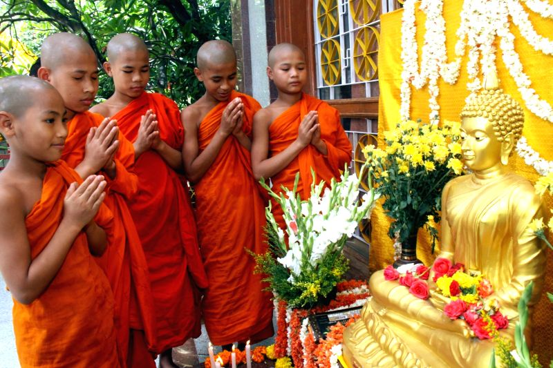 Budhist monks offers prayer on the occasion of Buddha Jayanthi celebrations at Maha Bodhi Society, in Bengaluru on May 21, 2016.
