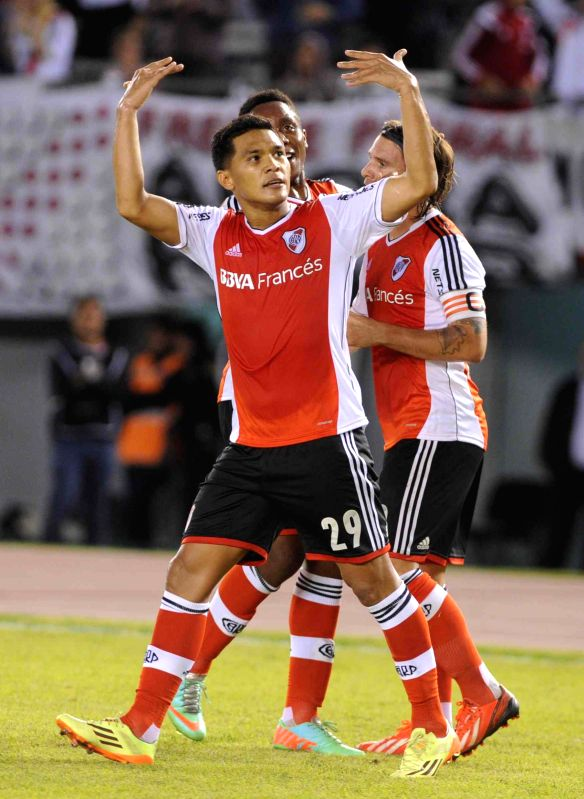 River Plate's player Teofilo Gutierrez(FRONT) celebrates scoring during a Final Tournament 2014 match against Velez Sarsfield in Buenos Aires, Argentina, ...