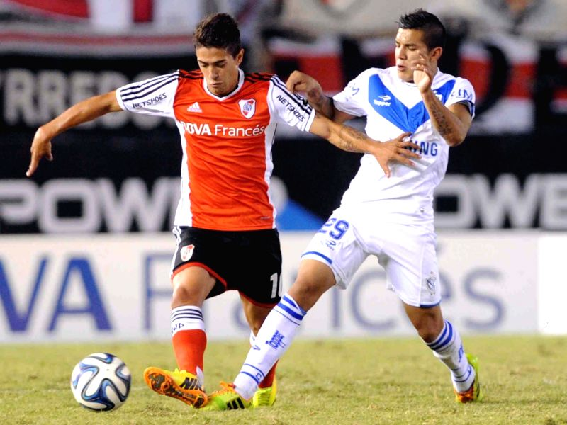 River Plate's player Manuel Lanzini(L) vies for the ball with Lucas Romero of Velez Sarsfield during a Final Tournament 2014 match in Buenos Aires, Argentina,