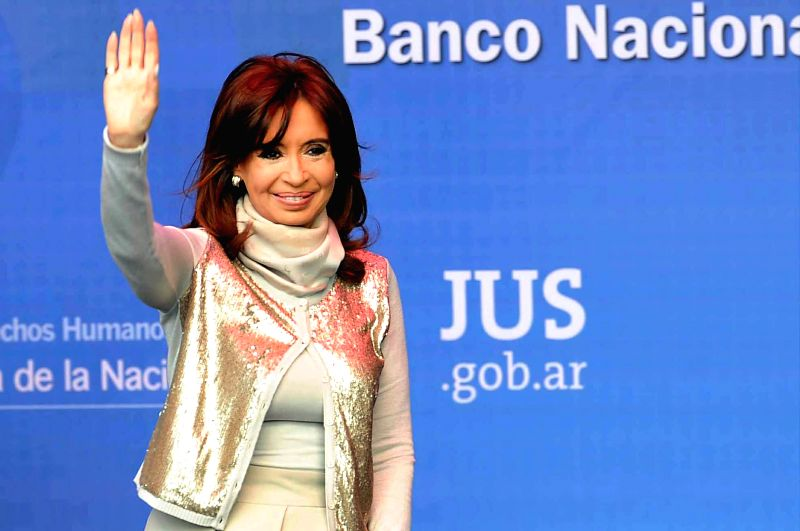 Argentina's President Cristina Fernandez waves upon her arrival at the inauguration ceremony of the new building of the National Bank of Controlled Materials ...