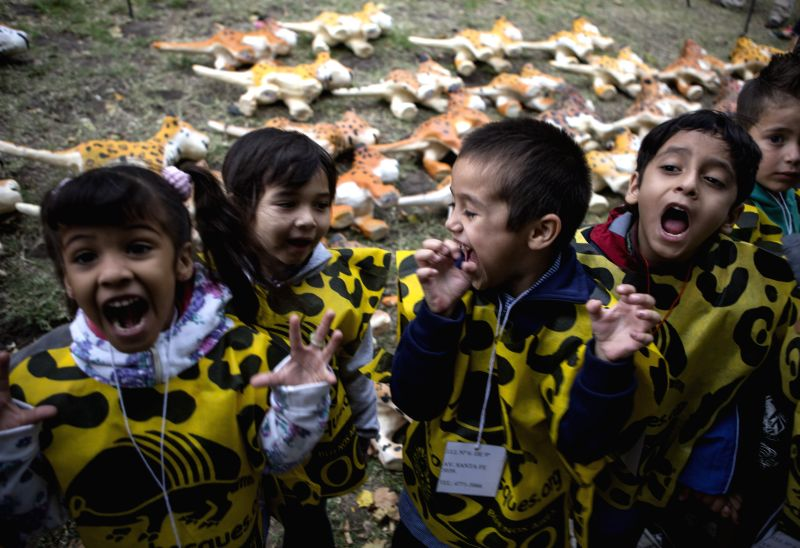 """Children take part in an activity held by the Buenos Aires Zoo, the Bank of Forests and so-called """"Green Schools"""" in San Martin square, in Buenos ..."""