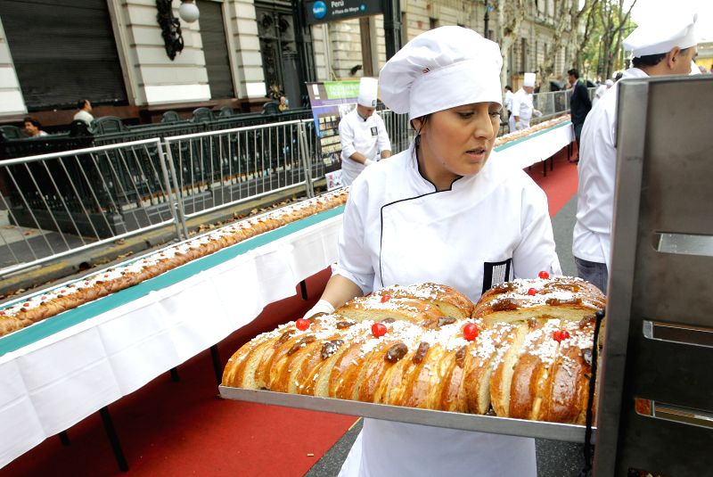 A master of pastry bakes slices of braided Easter bread on May Avenue, Buenos Aires, Argentina, on April 4, 2015. According to local press, the braided Easter ...