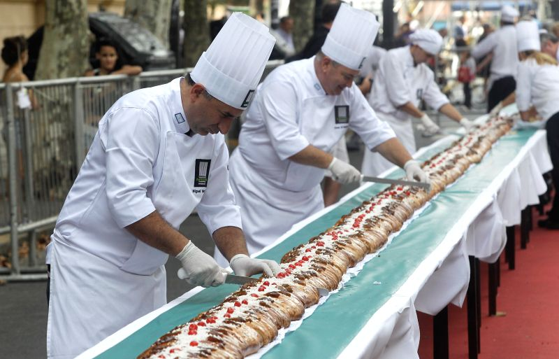 Masters of pastry slice braided Easter bread on May Avenue, Buenos Aires, Argentina, on April 4, 2015. According to local press, the braided Easter bread has ...