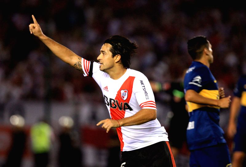 Buenos Aires (Argentina): River Plate's Leonardo Pisculichi, celebrates after scoring during the semifinal match of the South American Cup, against Boca Juniors, held at Antonio Vespucio Liberti ...