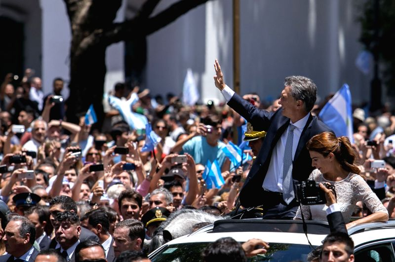 Buenos Aires: Argentina's President Mauricio Macri and his wife Juliana Awada meet with supporters after his inauguration in Buenos Aires, capital of Argentina, Dec. 10, 2015. (Xinhua/Sebastian ...