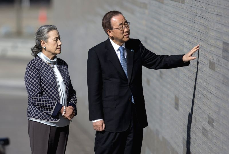 BUENOS AIRES, Aug. 10, 2016 - United Nations Secretary-General Ban Ki-moon (R) and his wife Yoo Soon-taek look at the wall inscribed with the names of people missing in the military dictatorship of ...
