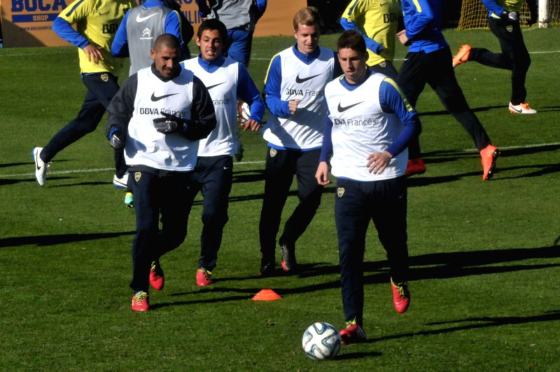 Boca Juniors'players take part in a training session, in Buenos Aires, Argentina, on Aug. 14, 2014.
