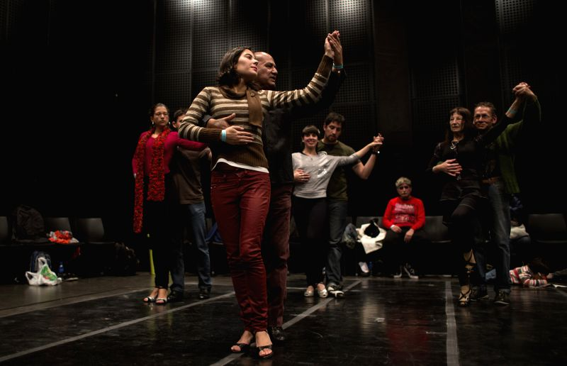 """Residents and tourists take part in an induction to """"Tango Escenario"""" class, during the Tango Festival of Buenos Aires, Argentina, on Aug. 15, 2014. ."""