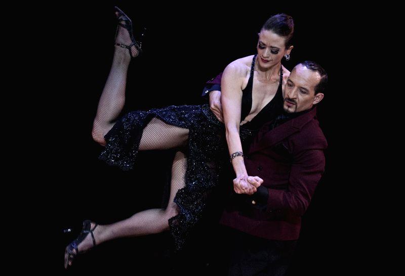 """Ana Lopera (L) and Julio Montoya (R) of Medellin, Colombia, dance tango during the final of """"Escenario"""" (scenario) mode of the Tango World ..."""