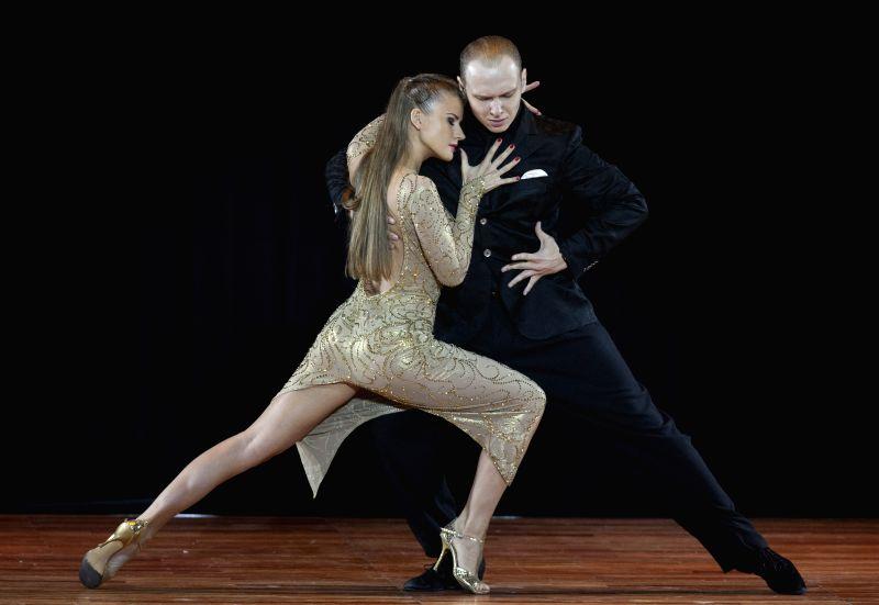 "Ekaterina Simonova (L) and Stanislav Fursov (R) of Moscow, Russia, dance tango during the final of ""Escenario"" (scenario) mode of the Tango World ..."