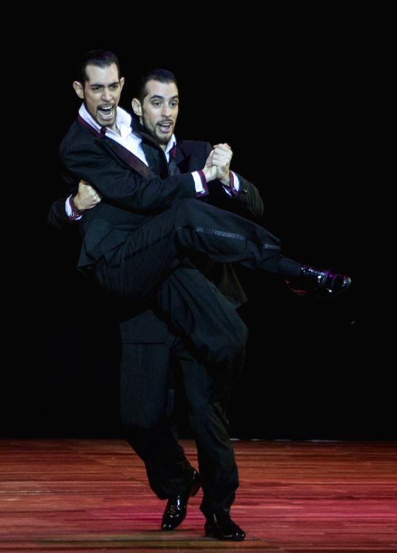 """German Filipeli (L) and Nicolas Filipeli (R), dance tango during the final of """"Escenario"""" (scenario) mode of the Tango World Championship, at Luna ..."""