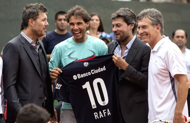 (From L to R) San Lorenzo's Club Vice President and TV host Marcelo Tinelli, Spanish tennis player Rafael Nadal, San Lorenzo's Club President Matias Lammens, ...