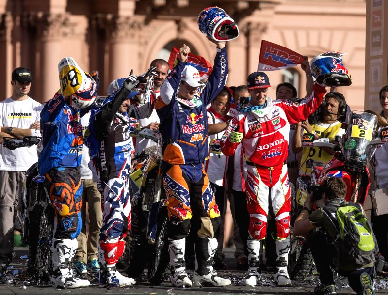 Motorcyclists Jordi Viladoms of Spain, Olivier Pain of France, Marc Coma of Spain and Joan Barreda Bort of Spain (From L to R, Front), react during a symbolic ..