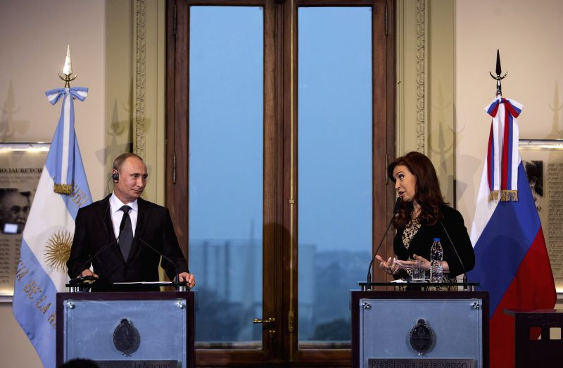 Argentinean President Cristina Fernandez (R) delivers a speech during a joint statement with her Russian counterpart Vladimir Putin in the conference hall of ..