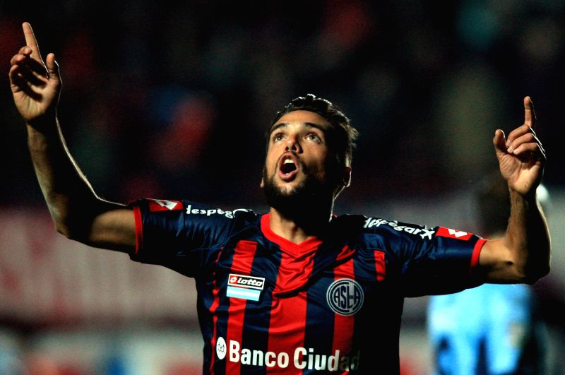 Emanuel Mas of Argentina's San Lorenzo celebrates after scoring during the first leg semifinal match of the 2014 Libertadores Cup against Bolivia's Bolivar ...