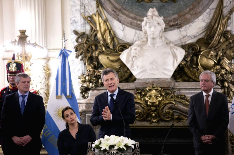 BUENOS AIRES, June 13, 2017 - Argentina's President Mauricio Macri (C) delivers a speech during the swearing-in ceremony of the new Argentine Foreign Minister Jorge Faurie in Buenos Aires, capital of ... - Jorge Faurie