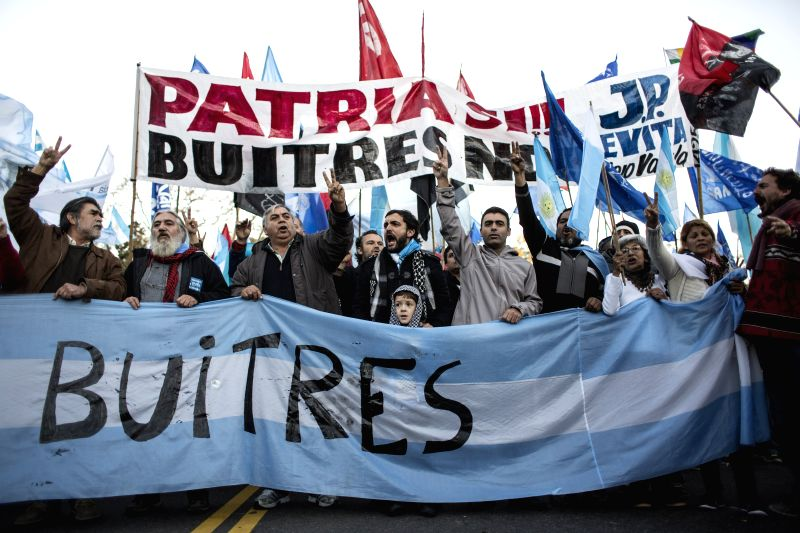 """Residents take part in a protest against the """"holdouts"""" in front of the U.S. embassy in Buenos Aires, capital of Argentina, on June 20, 2014. U.S. ..."""