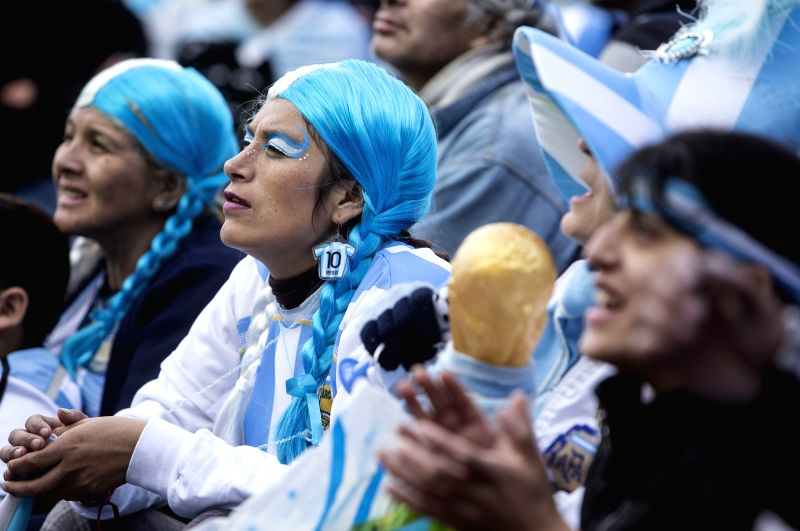Argentina's fans react while watching the broadcast of a Group F match between Argentina and Nigeria of 2014 FIFA World Cup on a screen installed in San Martin